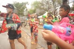 Childs enjoy splashing water in Songkran festival. AYUTTAYA, THAILAND - APRIL 15: Thai people enjoy splashing water together in songkran festival ( water stock photography