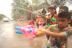 Childs enjoy splashing water in Songkran festival. Stock Photos