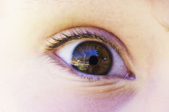 Childs eye reflection in Cornea Royalty Free Stock Photo