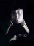 childs förvriden framsida Arkivbilder