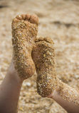Childs feet at the beach Stock Photo