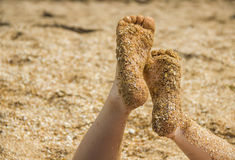 Childs feet at the beach Stock Photography