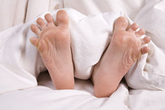 Childs feet in bed Royalty Free Stock Photography