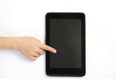 Childs finger showing on tablet on white background Stock Photos