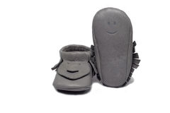 Childs gray booties on a white background Stock Photo