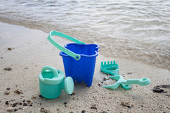 Childs green beach bucket and spades Royalty Free Stock Photography