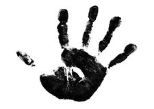Childs hand. A Childs hand print made from black paint stock image