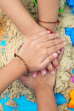 Childs hand close up playing kinetic sand Stock Images