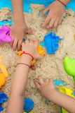 Childs hand close up playing kinetic sand Royalty Free Stock Photo