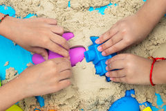 Childs hand close up playing kinetic sand Royalty Free Stock Photography