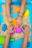 Childs hand close up playing kinetic sand Royalty Free Stock Image