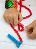 Childs hand loom banding royalty free stock photography