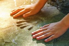 Childs hand and memorable handprint in concrete Stock Photo