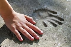 Childs hand and memorable handprint in concrete.  stock images