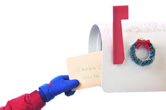 Childs hand placing letter in Mailbox isolated Royalty Free Stock Images