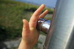 Childs hand in summer. Childs hand on a beach shower in summer stock photography