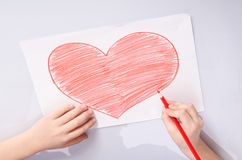 Free Childs Hands Drawing A Heart Stock Photography - 75039312