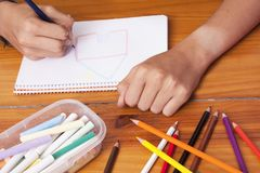 Childs hands by drawing Stock Images