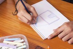 Childs hands by drawing Stock Photo