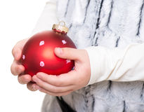 Childs hands holding red christmas ball Royalty Free Stock Photos