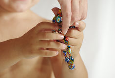 Childs hands taking the toy from his mothers hand Royalty Free Stock Photo