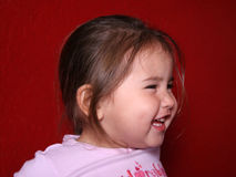 Childs Laughter. Profile of Young Child laughing royalty free stock photography