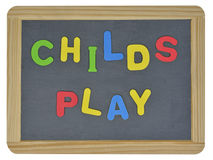 Childs lek i kulöra bokstäver Arkivbild
