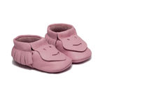 Childs light pink booties on a white background Stock Image