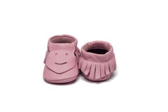 Childs light pink booties on a white background Stock Photography