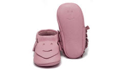 Childs light pink booties on a white background Royalty Free Stock Photography