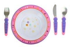 Childs Nahrungsmittelplatte mit dem Tischbesteck getrennt auf Weiß Stockbilder