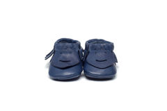 Childs navy blue booties on a white background Royalty Free Stock Photography