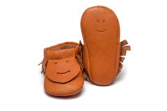 Childs orange booties on a white background Royalty Free Stock Photos