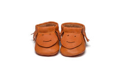 Childs orange booties on a white background Royalty Free Stock Image