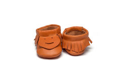 Childs orange booties on a white background Royalty Free Stock Images