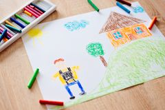 Childs pastel drawing of boy going to school. stock images