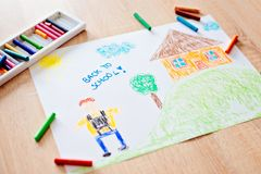 Childs pastel drawing of boy going to school. Royalty Free Stock Images