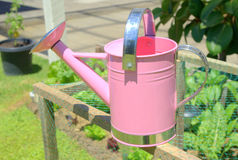 Childs pink watering can Stock Image