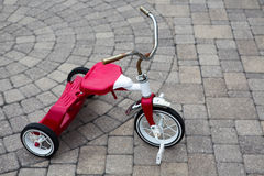 Childs Red Tricycle Parked Royalty Free Stock Photography