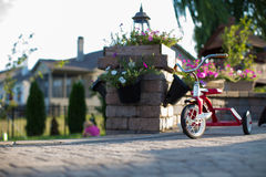 Childs Red Tricycle On A Patio Royalty Free Stock Photo