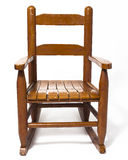 Childs Rocking Chair White. A worn child's rocking chair on white stock image