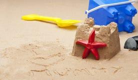 Childs sandcastle on beach. Stock Photos