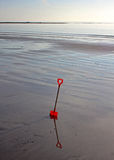 Childs spade on the beach Royalty Free Stock Photos