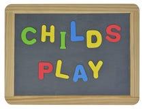 Childs-Spiel in farbigen Buchstaben Stockfotografie