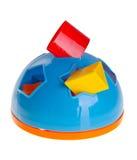 Childs Spielzeug-Formsorter auf Hintergrund Childs Spielzeug-Formsorter auf einem Hintergrund Lizenzfreies Stockbild