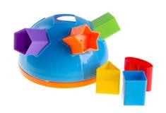 Childs Spielzeug-Formsorter auf Hintergrund Childs Spielzeug-Formsorter auf einem Hintergrund Stockfotografie