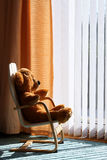 Childs Teddy Bear relaxing in the sunshine. Childrens toy teddy bear relaxing in the sun in a comfortable chair Stock Photography