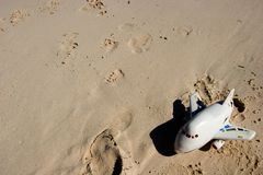 Childs toy on beach. Abandoned child's toy on beach, good for concepts royalty free stock photos