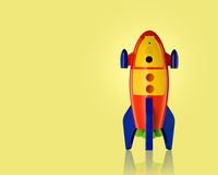Childs toy rocket on white background Stock Images
