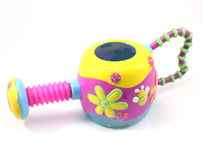 Childs toy sprinkler. With flowers on a white background Royalty Free Stock Images